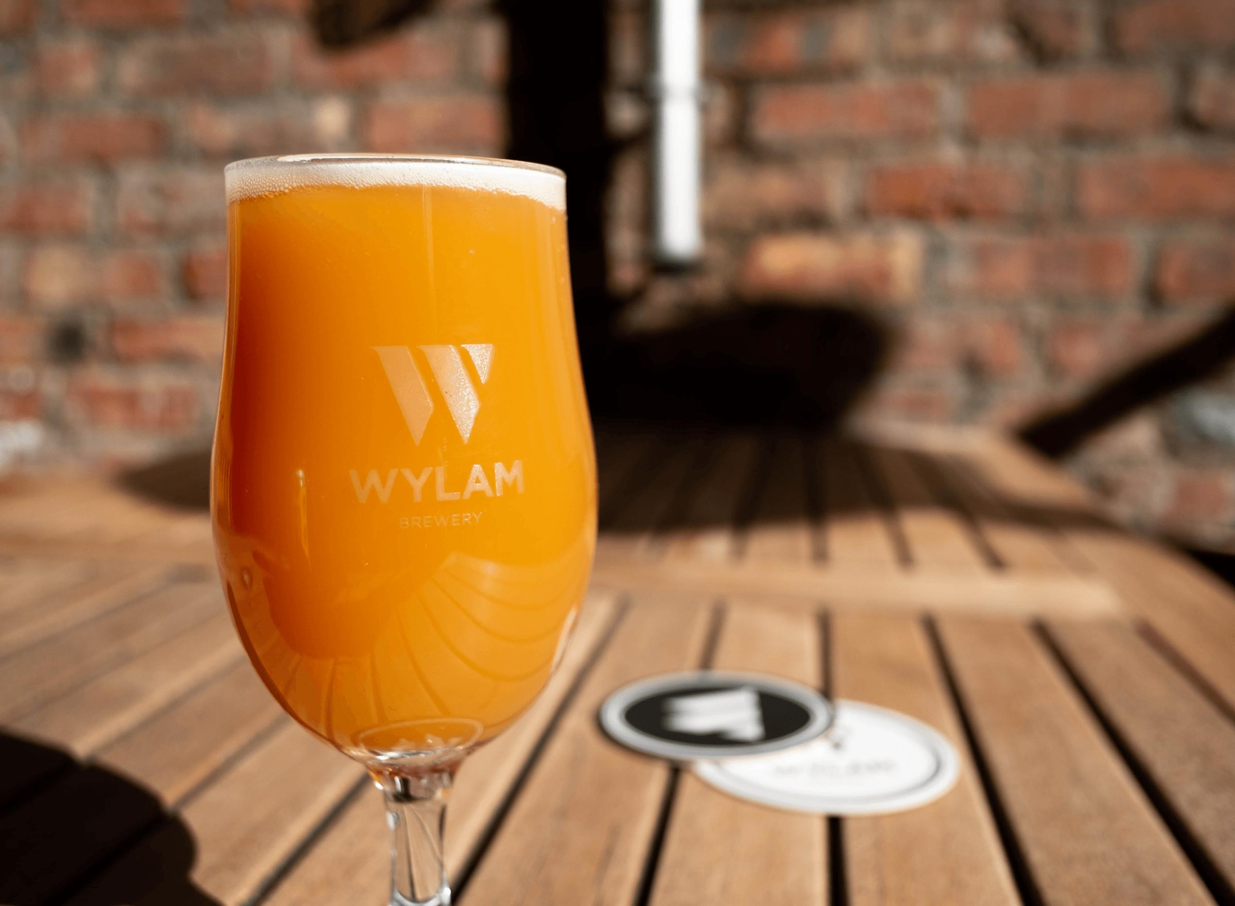 Logo design for Wylam Brewery on a beer glass