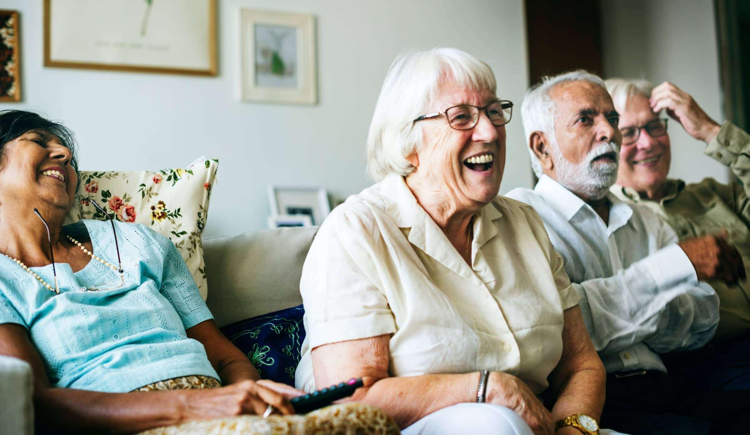 Older people enjoying themselves at a volunteer meeting